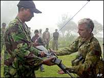 A previous handover, when Alfredo Reinado (left) handed weapon to Australian soldier - 16/6/06