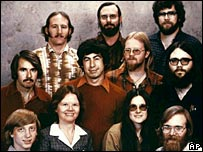 Microsoft's first eleven employees, including Bill Gates, bottom left, and Paul Allen, bottom right