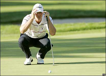 Steve Stricker lines up a putt on the 13th green