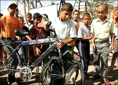 Boy retrieves damaged bicycle
