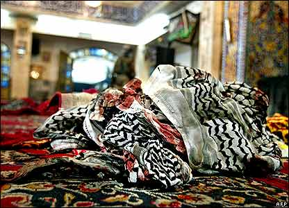 Bloodstained keffiyeh on the floor of bombed mosque