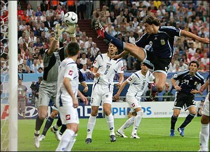 Hernan Crespo has an acrobatic shot on goal