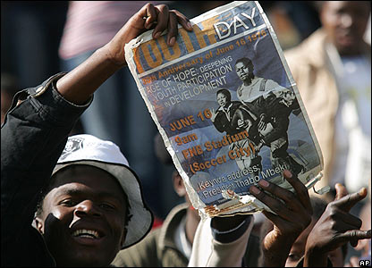 A South African youth holds a poster