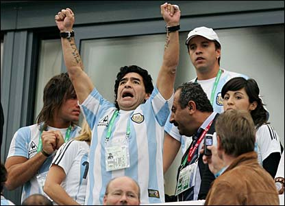 Diego Maradona cheers on from the stands
