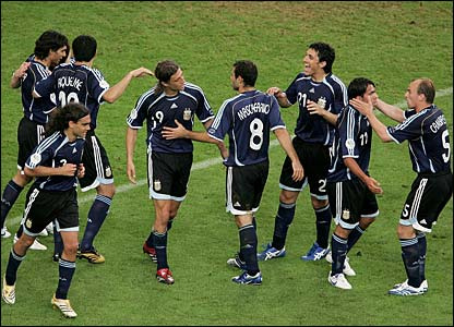 Hernan Crespo is mobbed by his team-mates after scoring