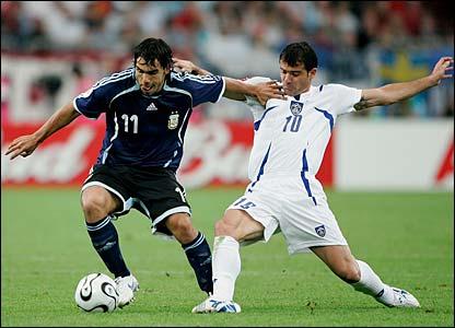 Carlos Tevez skips past Dejan Stankovic