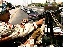 Soldier mans Baghdad checkpoint