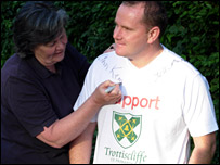Ann Kemp, chair of Trottiscliffe Parish Council, signing a T-shirt worn by parent Robin Lee