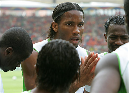 Didier Drogba talks to his team-mates 