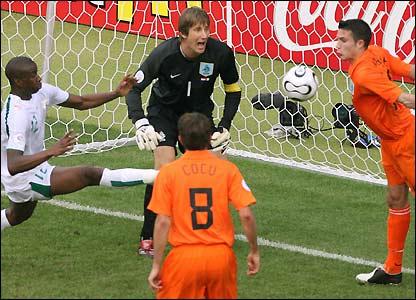 Robin van Persie clears off the line