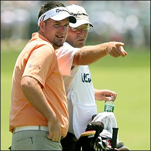 Kenneth Ferrie (left) and caddie Gary Tilston