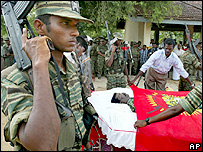 Tamil Tiger rebels drape the body of top leader Col Ramanan killed in May