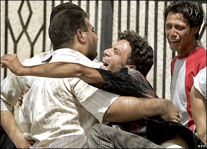 Youths mourn outside a Baghdad hospital