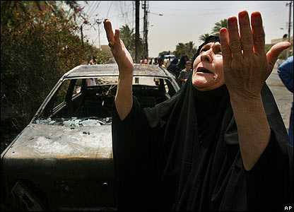 Woman raises her hands near scene of minibus attack