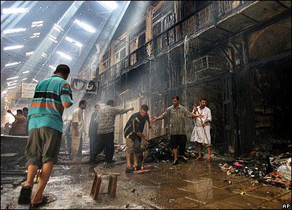 Clearing up at Isterbadi market in the predominantly Shia suburb of Kazimiyah