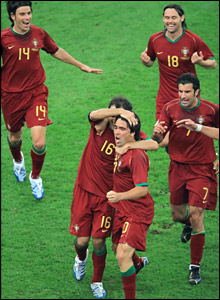 Deco is congratulated by teammates