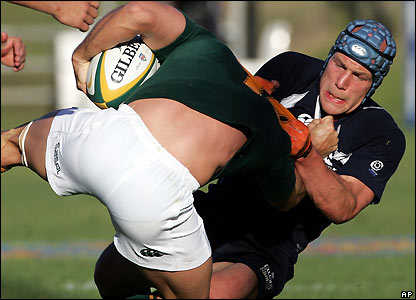 "Simon Webster tackles South Africa""s Jaco van der Westhuyzen"