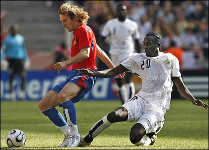Czech midfielder Pavel Nedved holds off a challenge from Ghanaian midfielder Otto Addo