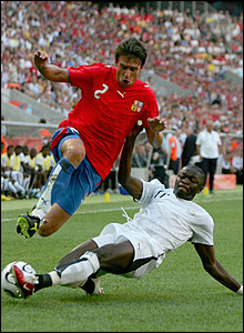 Ghana's Sulley Muntari takes the ball from Zdenek Grygera of the Czech Republic