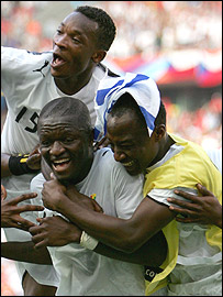 Sulley Muntari, bottom left, celebrates his late strike