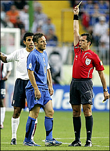 Francesco Totti (centre) is shown the yellow card