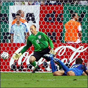Alberto Gilardino (right) heads the ball past USA keeper Kasey Keller