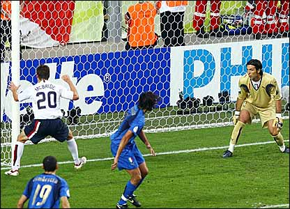 America's Brian McBride (left) watches the ball go into the net while Italian defender Cristian Zaccardo  (centre) and keeper Gianluigi Buffon look on