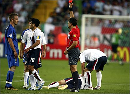 Daniele De Rossi (left) looks at referee Jorge Larrionda in disbelief after being shown the red card