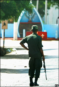 A Sri Lankan Army soldier stands guard in front of a church on a street of Mannar