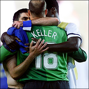 USA goalkeeper Kasey Keller is congratulated by his team-mates