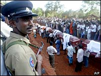 Sri Lankan policeman at a mass funeral