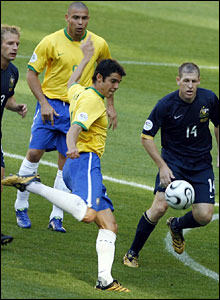 Brazilian midfielder Kaka (C-front) takes a shot as Australian midfielder Vince Grella (L), Brazilian forward Ronaldo (2nd L-behind) and Australian defender Scott Chipperfield (R) look on