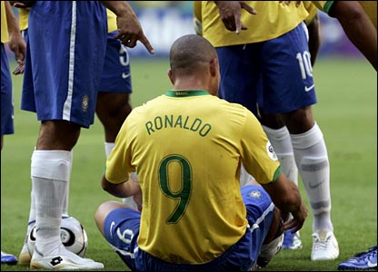 Ronaldo sits on the turf after a foul from Vince Grella