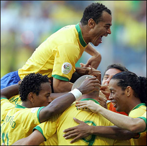 Brazilian defender Cafu (top) jumps on the back of Brazilian forward Adriano as he celebrates with team-mates