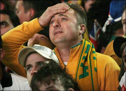 An Australian fans watches the action in despair on a screen in Australia