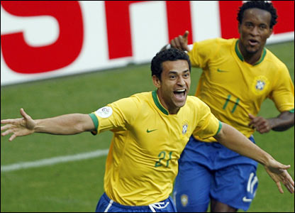 Brazilian forward Fred celebrates with team-mate Ze Roberto after scoring his team's second goal 