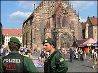 German police in city square