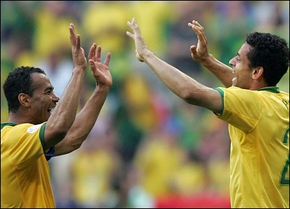 Brazilian defender Cafu high-five's Brazilian forward Fred on scoring the team's second goal 