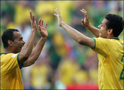 Brazilian defender Cafu high-five's Brazilian forward Fred on scoring the team's second goal