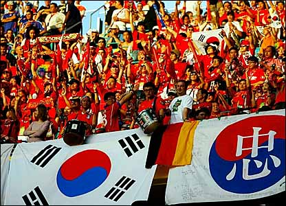 South Korea supporters welcome their side onto the pitch