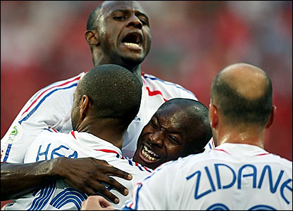 France goalscorer Thierry Henry (left) is congratulated by William Gallas (centre), Patrick Vieira (rear) and Zinedine Zidane