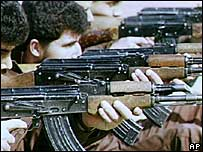 Fighters with Kalashnikov rifles