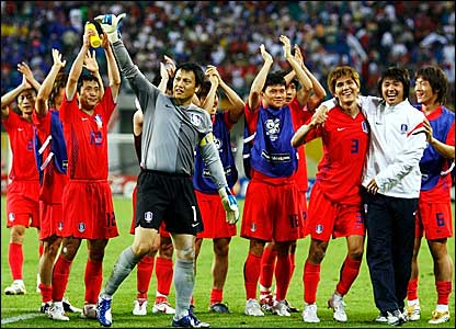 The South Korea players applaud their fans