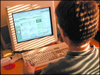 A student surfs the web on a home PC
