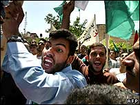 Hamas supporters demonstrate outside Palestinian parliament building in Ramallah