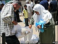 Palestinians in Gaza City receive food aid from the UN