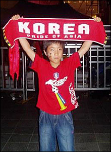 A Korean fan holding his team's flag