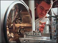 Nexia scientist reviews a test tube