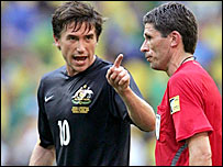 Harry Kewell has words with referee Markus Merk