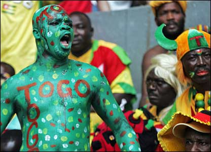 A Togo fan waits for the match to start